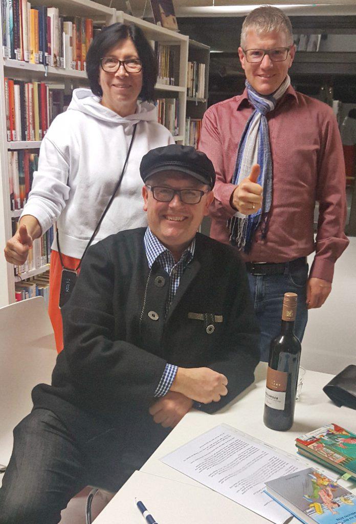 Olaf Nägele, umrahmt von Fr. Feger u. Ulrich Martens